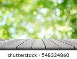 wood shelf on blurred green... | Shutterstock . vector #548324860