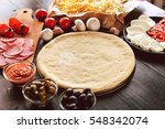 raw pizza ingredients on wooden ... | Shutterstock . vector #548342074