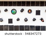 pottery items on a wall in... | Shutterstock . vector #548347273