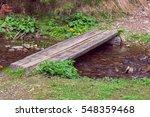 Wooden Crossbar Over A Stream...