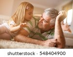 grandpa and granddaughter... | Shutterstock . vector #548404900