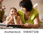 grandmother reading book to... | Shutterstock . vector #548407108