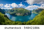 Panoramic aerial wide angle landscape of Geiranger fjord from mountain viewpoint. High resolution panorama, Geirangerfjord, Norway. - stock photo