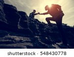 couple hiking help each other... | Shutterstock . vector #548430778