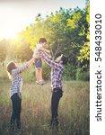 happy young family spending... | Shutterstock . vector #548433010