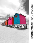 Row Of Painted Beach Huts In...