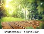 wooden desk in garden and free... | Shutterstock . vector #548458534
