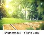 wooden desk in garden and free... | Shutterstock . vector #548458588