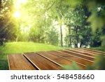 wooden desk in garden and free... | Shutterstock . vector #548458660
