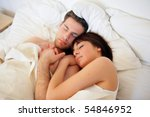 young couple sleeping in a bed | Shutterstock . vector #54846952