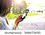 woman using smartphone in the...   Shutterstock . vector #548473450