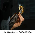 A Man's Hand Playing An...