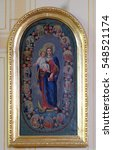 Small photo of KRASIC, CROATIA - JUNE 11: Virgin Mary Queen of the Holy Rosary altarpiece in parish church of the Holy Trinity in Krasic, Croatia on June 11, 2016