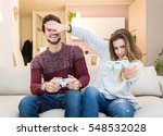 Young Couple Playing Videogame...