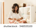 mother changing a diaper on... | Shutterstock . vector #548535103