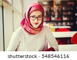 muslim student at the library | Shutterstock . vector #548546116