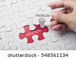 Hand Holding Piece Of Jigsaw...