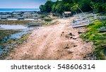 Small photo of Fisher Boats at low tide near seaweed plantations algal - Nusa Penida, Bali, Indonesia