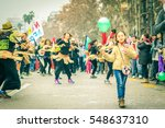 """Small photo of SANTIAGO, CHILE - JULY 24, 2016 : A happy girl is dancing near a group of dancers during a strike agains """"AFP"""" Chilean economical system."""