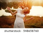 happy gorgeous bride smiling... | Shutterstock . vector #548658760