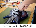 luthier working on a guitar in... | Shutterstock . vector #548685136