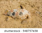 Sea Turtle Made Of Sand On The...
