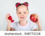 little girl with an apple and... | Shutterstock . vector #548772118