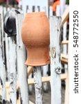 on a fence the burst ceramic... | Shutterstock . vector #548772550
