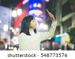 beautiful asian girl taking... | Shutterstock . vector #548773576