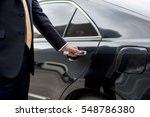 businessman handle limousine... | Shutterstock . vector #548786380