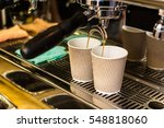 close up of espresso pouring... | Shutterstock . vector #548818060