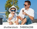 father and son relaxing near a... | Shutterstock . vector #548836288
