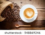 coffee latte with coffee beans | Shutterstock . vector #548869246
