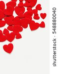 red hearts scattered on a white ... | Shutterstock . vector #548880040