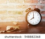 retro black alarm clock with... | Shutterstock . vector #548882368
