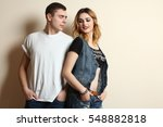 fashion man and woman posing in ... | Shutterstock . vector #548882818
