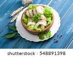 fresh hake on wooden background   Shutterstock . vector #548891398