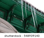 icicles on the roof of a wooden ... | Shutterstock . vector #548939140