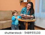 mom and little boy eating cake... | Shutterstock . vector #548955133