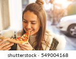 Beautiful Young Girl Eating A...