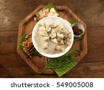Small photo of oyster food thai tradition dish on wood plate and wooden table with onion,chilli,garlic,acardia