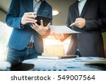 businessmen hands pointing at... | Shutterstock . vector #549007564