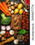 Small photo of Healthy food background. Healthy food concept with fresh vegetables and ingredients for cooking. Top view with copy space. Dark background.