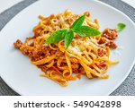 pasta bolognese on a plate on a ...   Shutterstock . vector #549042898