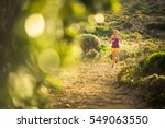 Young Woman Running Outdoors O...