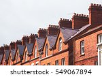 Chimneys On The Roof Of Town...