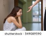 Small photo of Someone giving hand to depressed woman at home