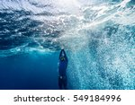 free diver ascending from the... | Shutterstock . vector #549184996