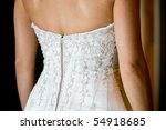 A close up of a caucasian bride's wedding dress at the back - stock photo