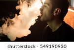 young handsome guy smoking... | Shutterstock . vector #549190930